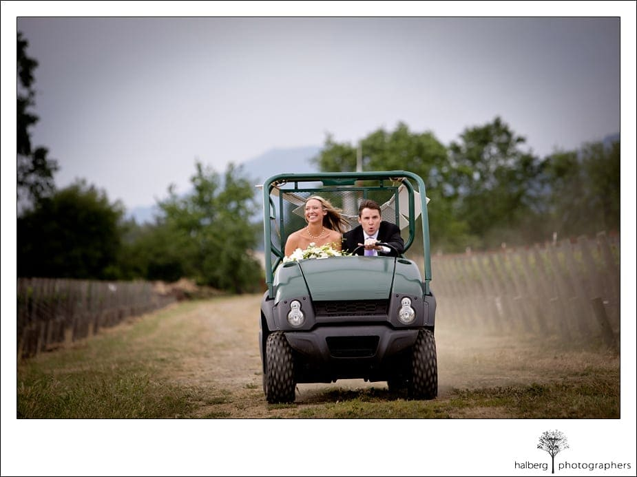 bride and groom driving around napa vineyard after wedding ceremony