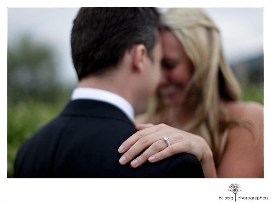 close up of ring on brides hand with groom at their Napa Vineyard Wedding