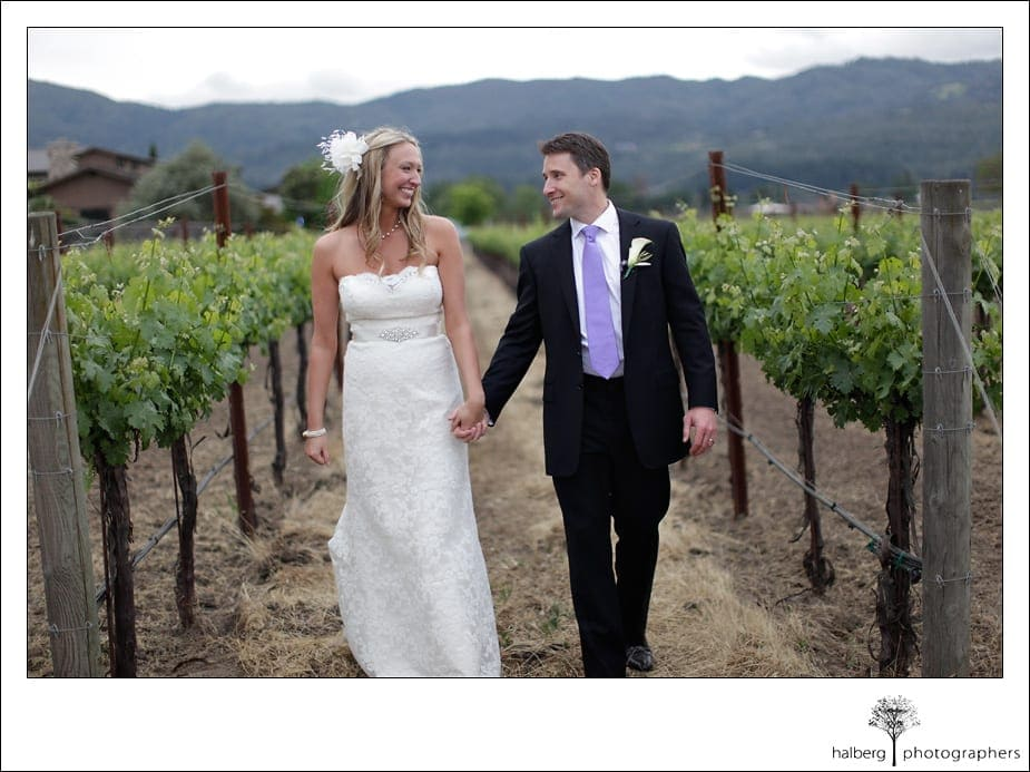 bride and groom walking through Napa Vineyard after their Wedding