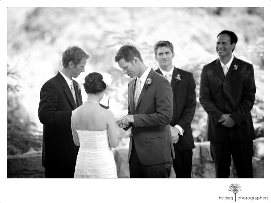 bride and groom exchange rings at their Elings Park Wedding