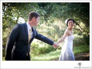 bride leading groom as they walk after their Elings Park Wedding