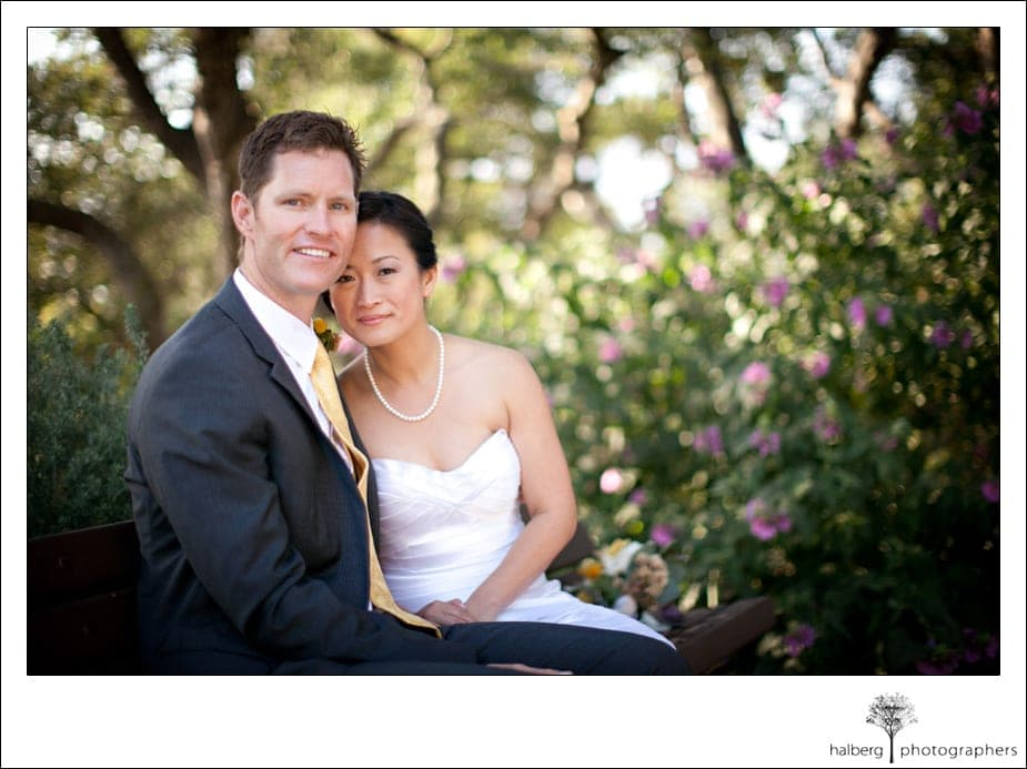 bride and groom sitting on bench after their Elings Park Wedding