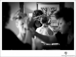 bride in mirror at Hotel Corque getting hair and make up done