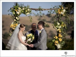 Firestone Vineyard Wedding couple holding hands at altar