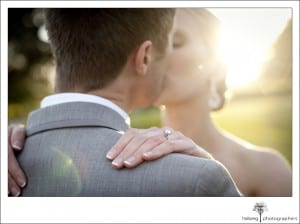 close up of brides ring on hand while bride and groom kiss after their Firestone Vineyard Wedding
