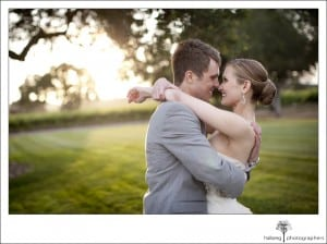 Firestone Vineyard Wedding couple holding and looking at each other