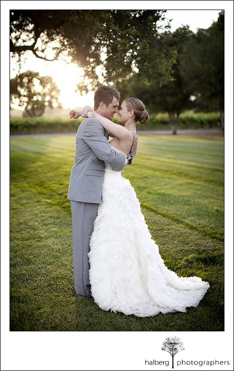 bride and groom holding each other after their Firestone Vineyard Wedding
