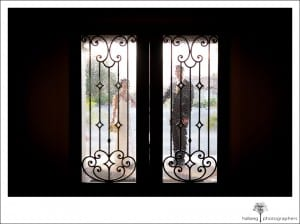 bride and groom standing outside door of their La Cumbre Country Club Wedding