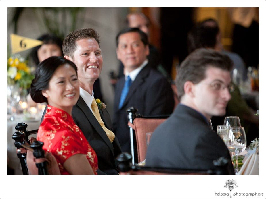 bride and groom sitting at table during toasts at their La Cumbre Country Club Wedding