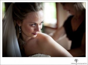 bride crying while wedding dress is put on at Nicholson Ranch