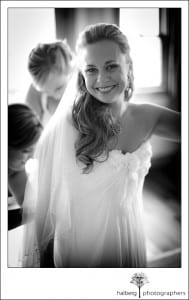 bride standing in wedding dress smiling at Nicholson Ranch