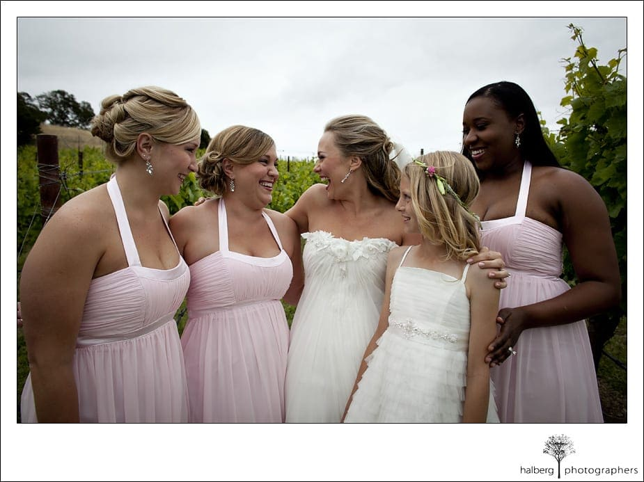 bride with bridesmaids in front of vineyards at her Nicholson Ranch Wedding