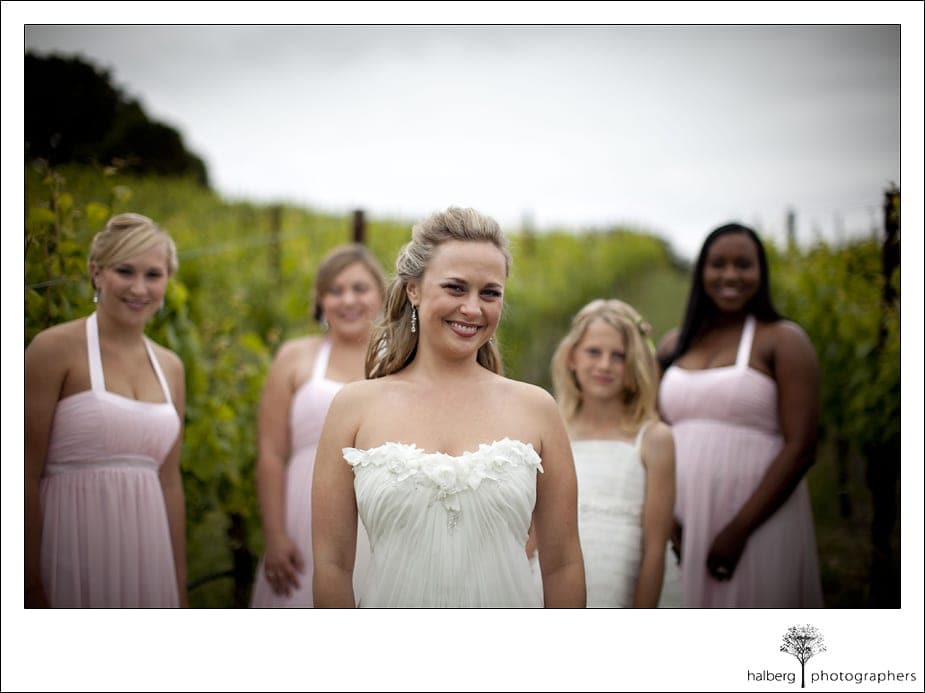 Nicholson Ranch Wedding bride in front of vineyards with bridesmaids