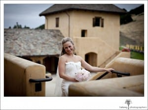 bride standing on stairs before her Nicholson Ranch Wedding