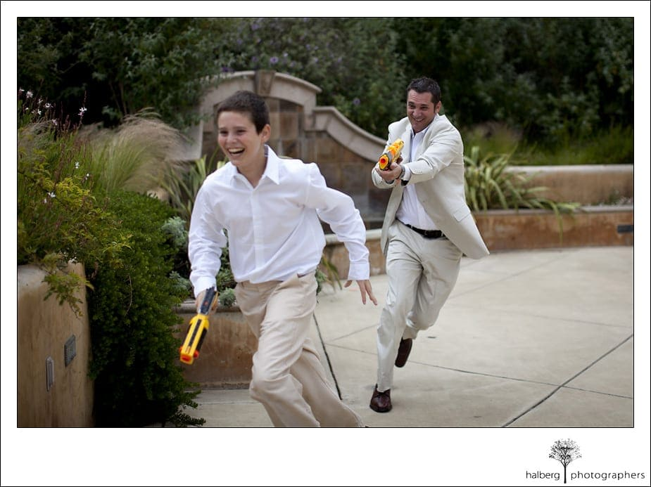 groom having nerf gun fight before his Nicholson Ranch Wedding