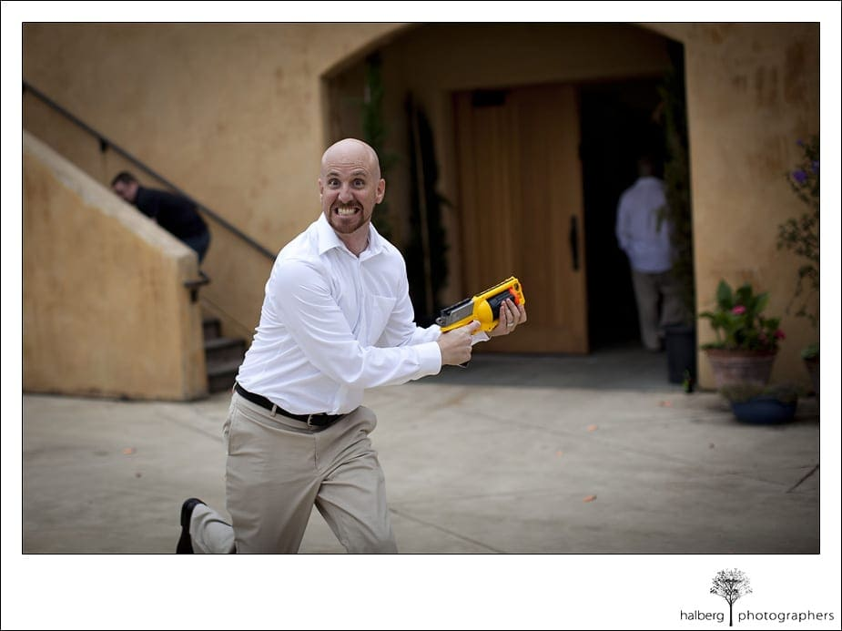 groomsman running with nerf gun before the Nicholson Ranch Wedding