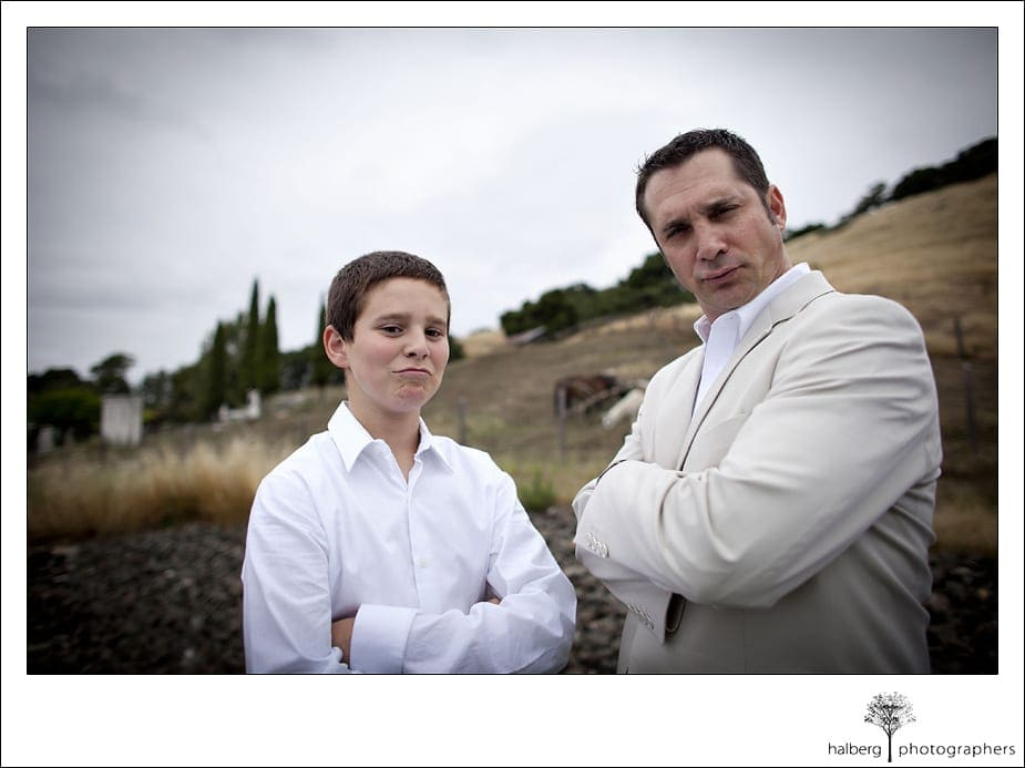 groom standing with son arms crossed before his Nicholson Ranch Wedding