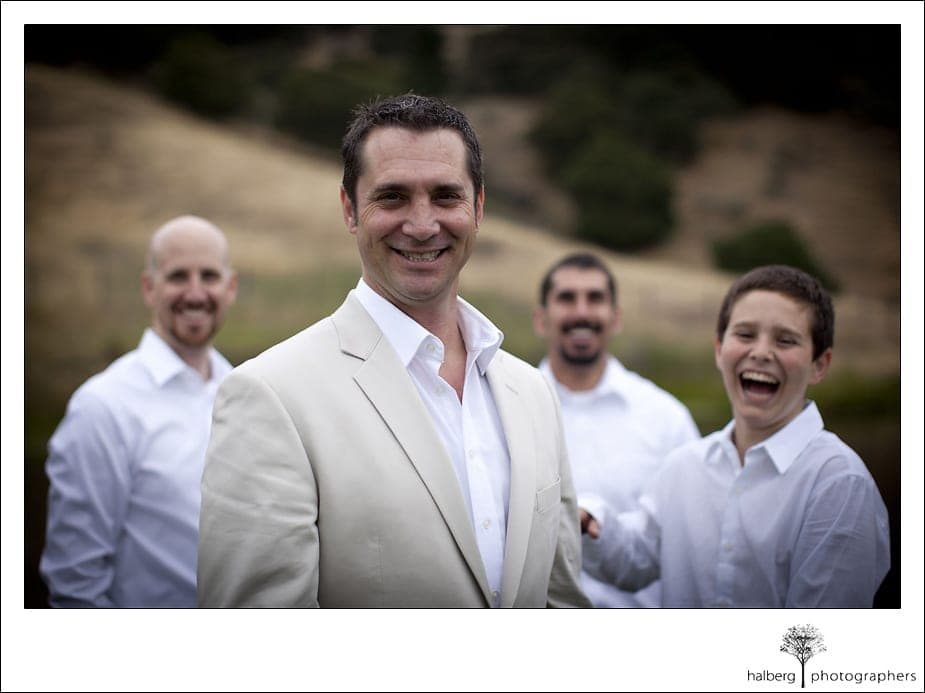 groom standing in front of groomsmen laughing at his Nicholson Ranch Wedding