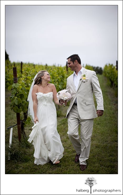 Nicholson Ranch Wedding bride and groom walking through vineyards