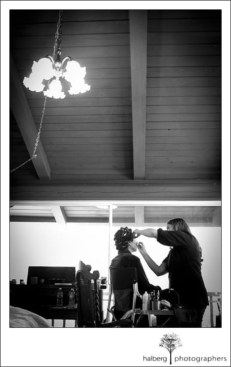 bride having makeup put on before her Riviera Country Club Wedding