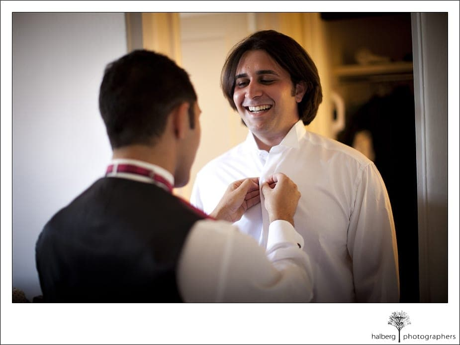 groom getting tie put on before his Riviera Country Club Wedding