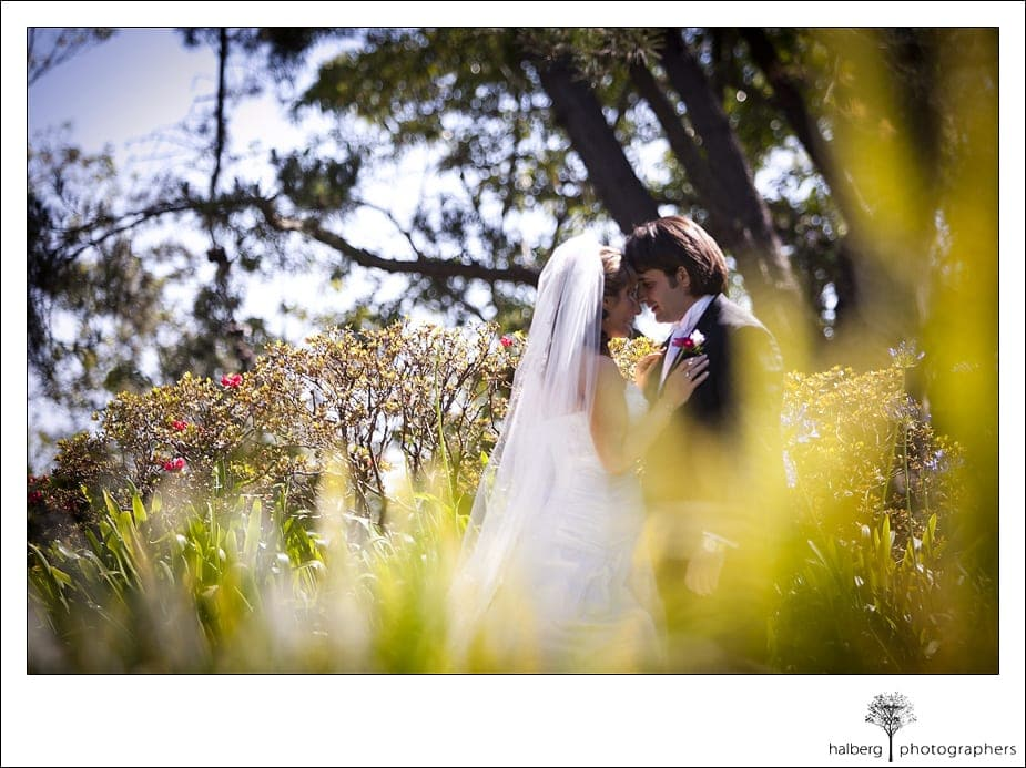Riviera Country Club Wedding couple embrace with foreheads touching