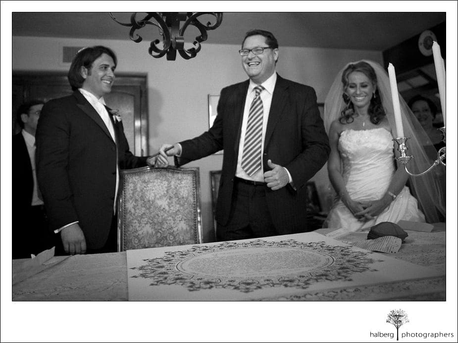 bride and groom sign ketubah before their Riviera Country Club Wedding