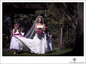 bride walking down isle with flower girls at her Riviera Country Club Wedding