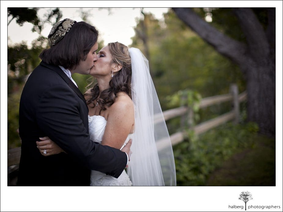 bride and groom kissing after their Riviera Country Club Wedding ceremony
