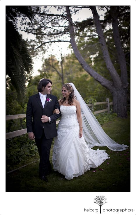 bride and groom walking arm in arm after their Riviera Country Club Wedding ceremony