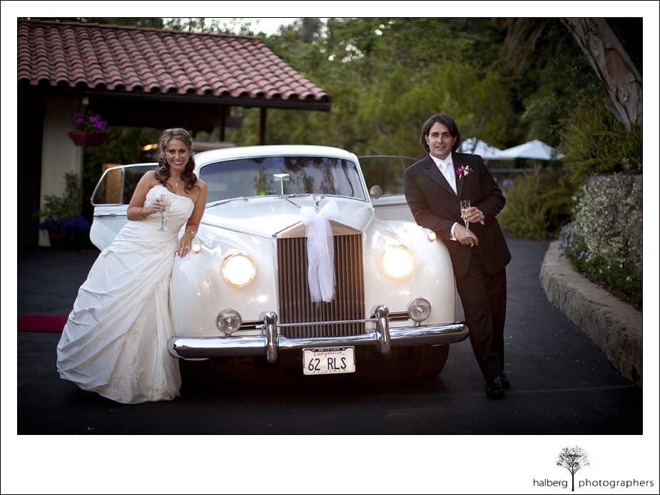 Riviera Country Club Wedding bride and groom with classic white rolls royce getaway car
