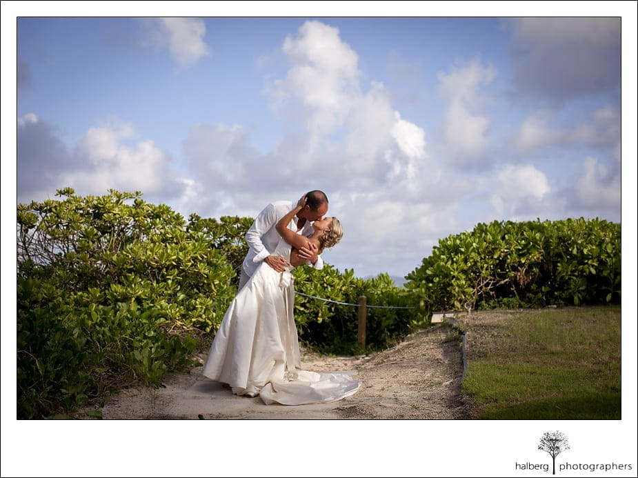 Couple embraces after wedding at CuisinArt Resort