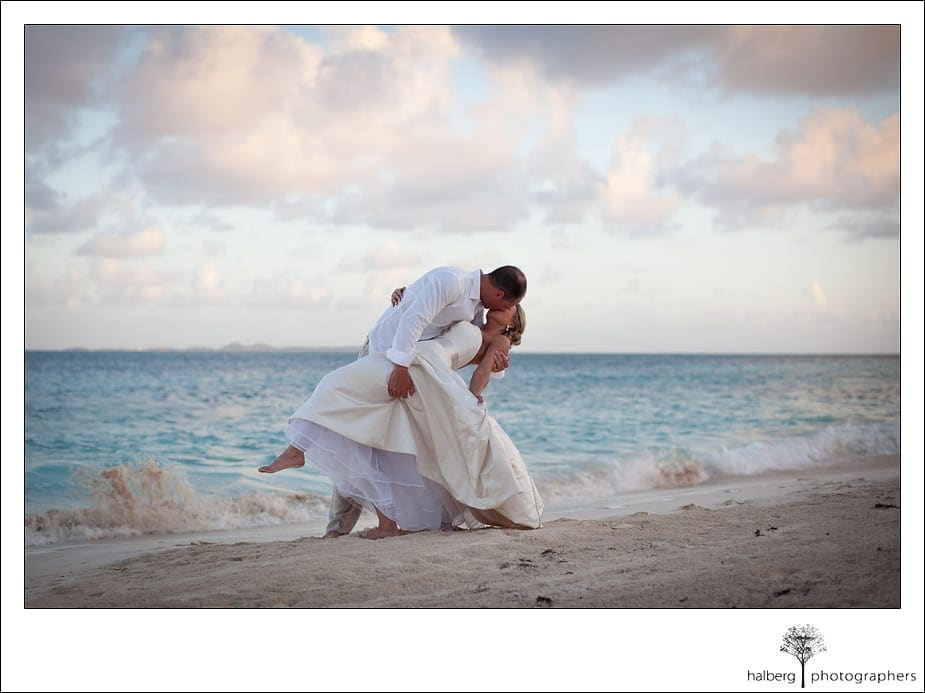 Intimate kiss along shore in Anguilla