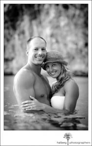 Newly weds pose in water of Anguilla