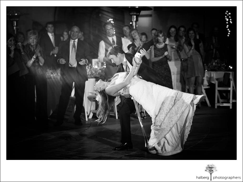 Groom dips his bride at their wedding reception at the Doubletree