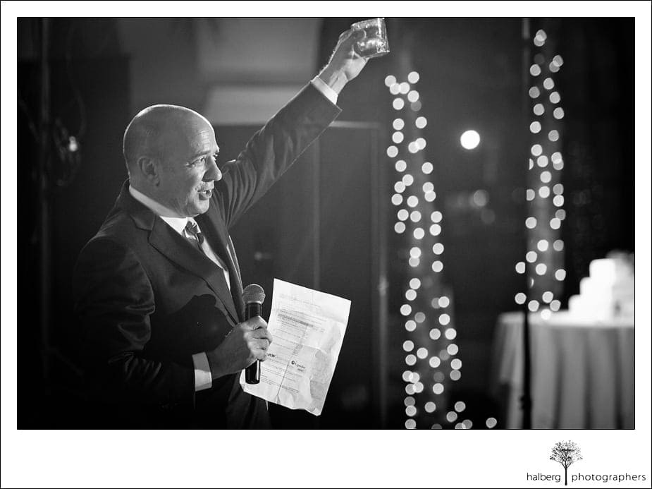 Guest toasting at wedding reception at the Doubletree