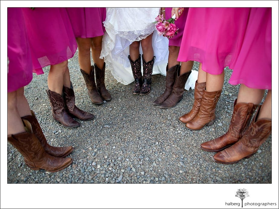 Bride shows of her cowboy boots at Grants Pass Wedding