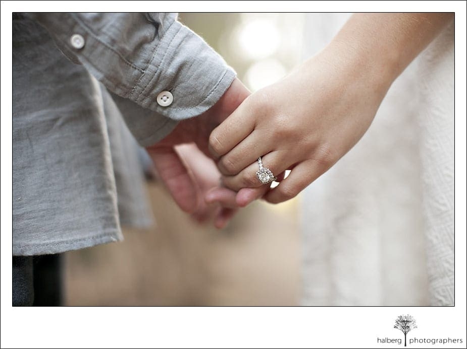 Couple interlocking fingers displaying engagement ring in Santa Barbara engagement session