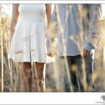 Engaged couple holding hands in a Santa Barbara field
