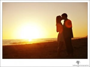 Couple sharing a kiss during their Santa Barbara sunset engagement session.
