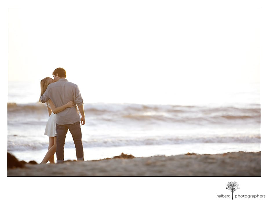 Couple kissing along the Santa Barbara shore during engagement session.