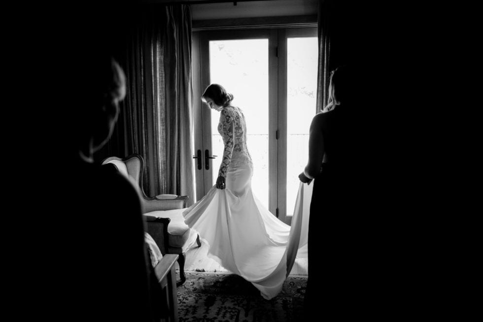 bride getting ready at pythian house cottage wedding