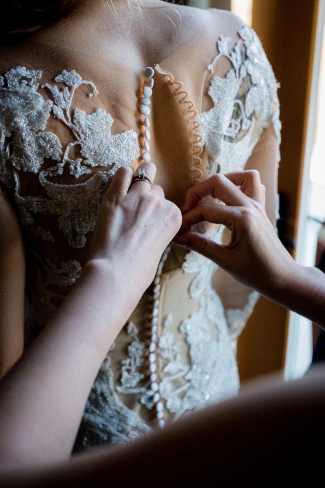 bride gets ready for pythian house cottage wedding