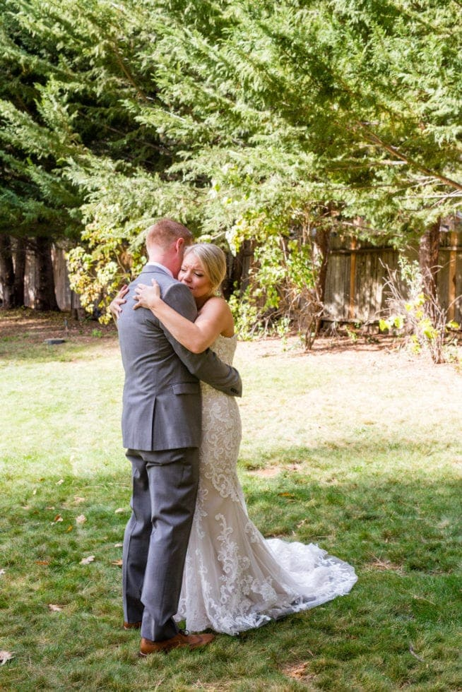 bride and groom embrace after first look