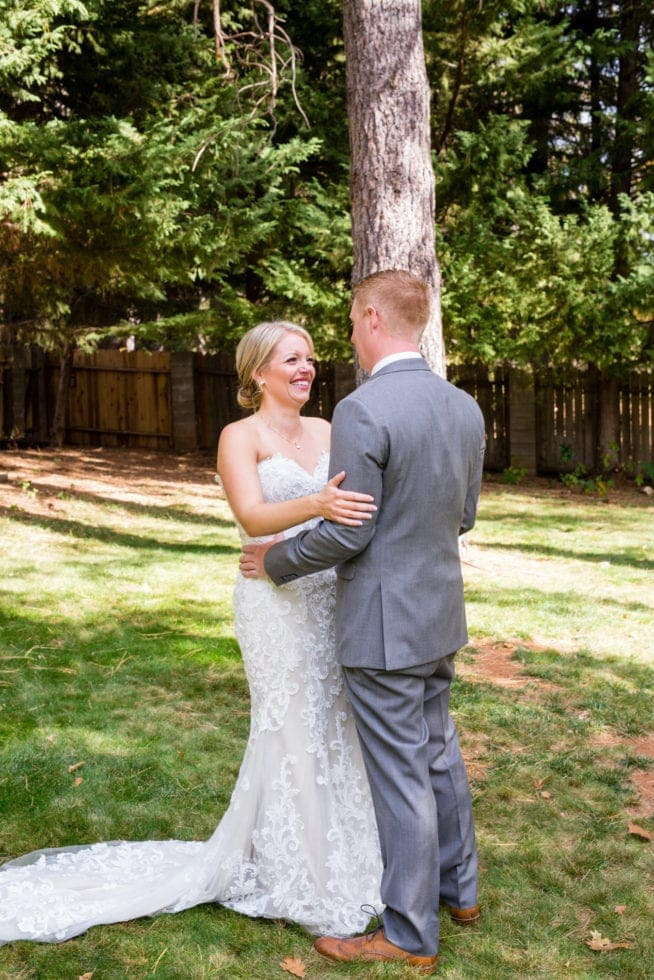 bride and groom smile at each other after first look