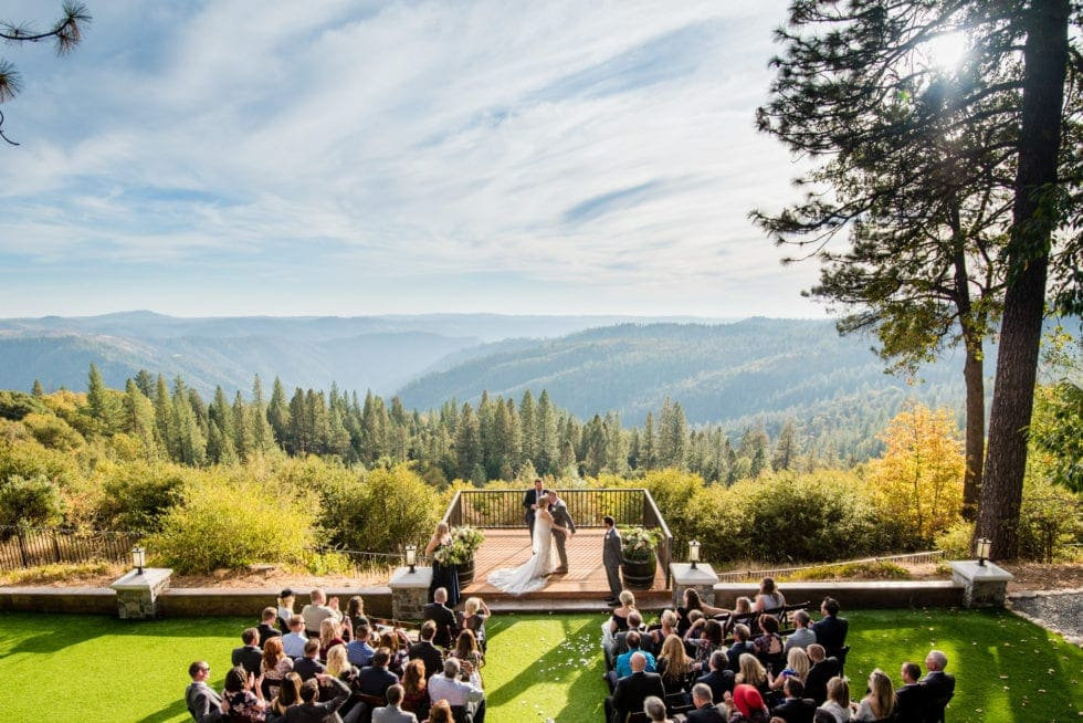 bride and groom first kiss during wedding ceremony at mountain shadows retreat in foresthill, ca