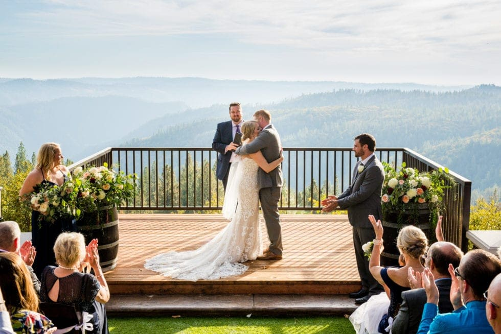 bride and groom hug during wedding ceremony at mountain shadows retreat in foresthill, ca