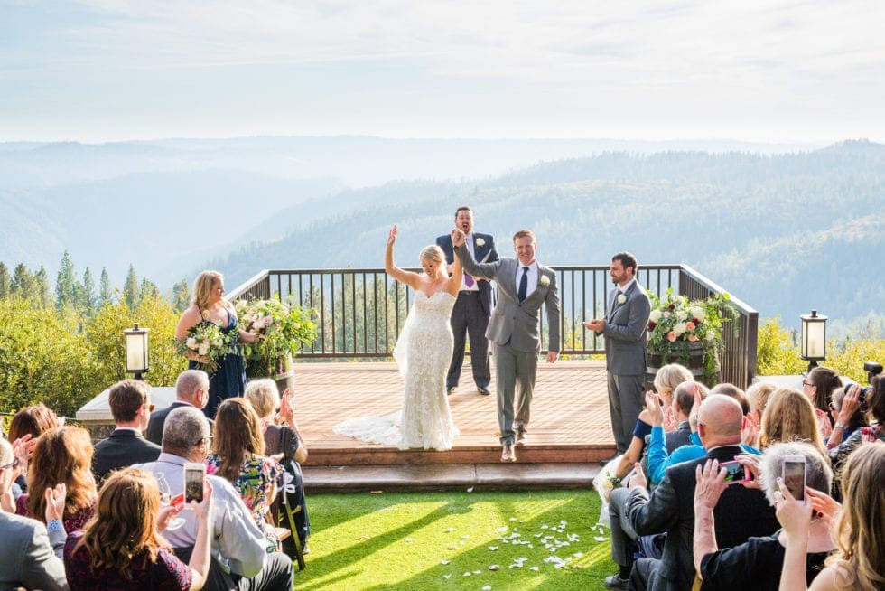 bride and groom walk down the aisle after wedding ceremony at mountain shadows retreat in foresthill, ca