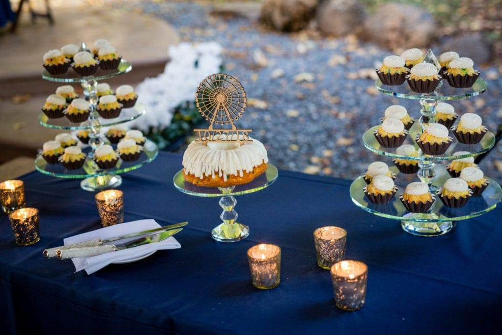 cupcake display table at wedding reception at mountain shadows resort in foresthill, ca