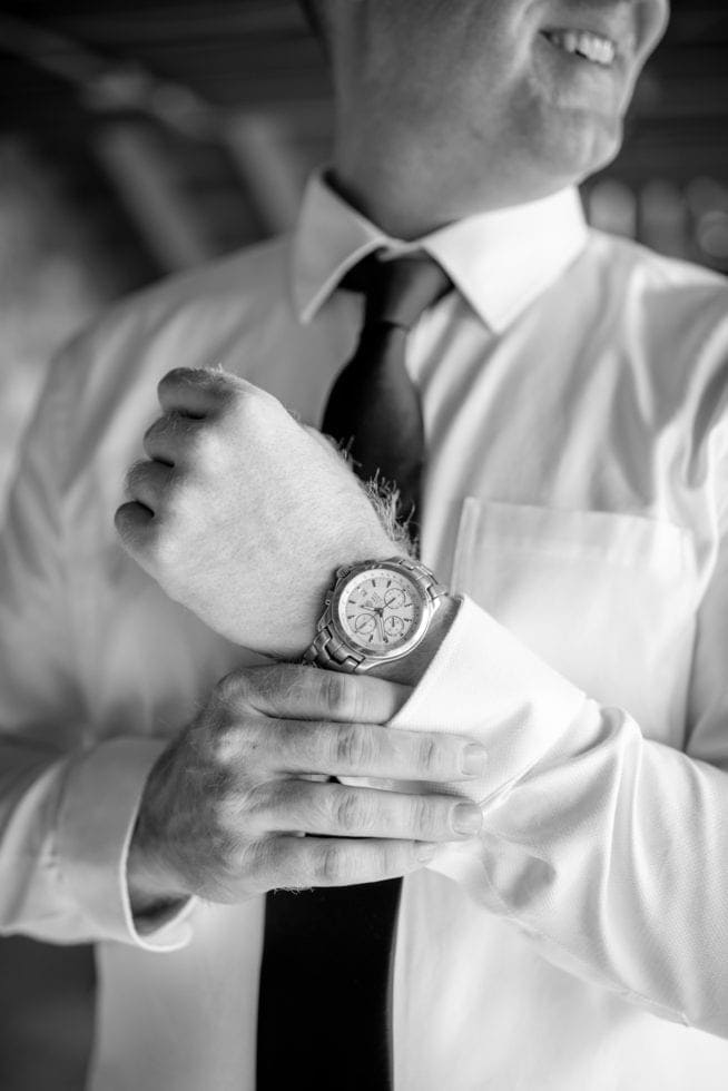 photo of groom's watch and suit